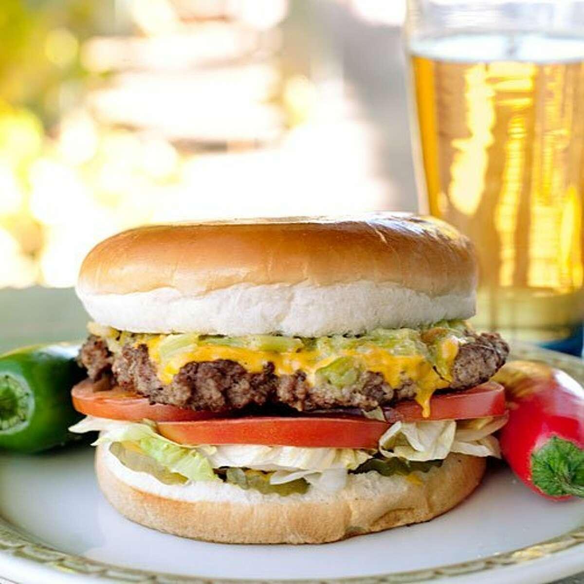 Buckhorn Tavern in San Antonio, TX serves up a green-chile burger as big as a big rig's hubcap.