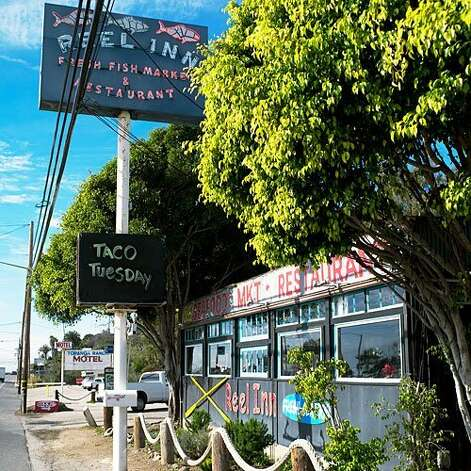Stop in at the Reel Inn in Malibu, CA after a long day of surfing (or lounging on the beach) to try fresh-caught salmon or ahi tuna tacos with an ocean view. Photo: Andrea Gómez Romero, Sunset