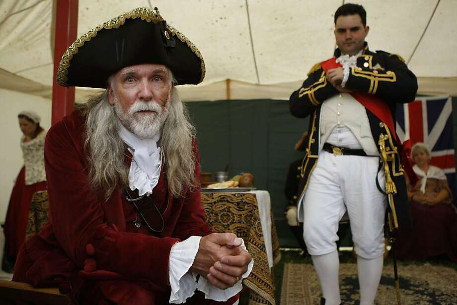 """Patrick Gaul (left) and Joe Harney (right) at the fifth annual Northern California Pirate Festival at the waterfront next to the ferry terminal in Vallejo, Calif., on Saturday afternoon,  June 18, 2011. Patrick Gaul heads Actions Past.com which is a portal for participants to reenact history, with costuming and setting for each.  Gaul is Woodes Rogers, Captain General and Governor in Chief of the British colony of the Bahamas, signing the king's pardon for those pirates seeking such attending the festival.  Joe Harney is Commodore Peter Chamberlaine, Captain of the HMS Milford, who tried keeping the pirates in line.  Gaul's garments were hand sewn by his wife a seamstress with over 25 years of experience in historical costuming, using a period correct pattern from The Recollections of J. P. Ryan (http://www.jpryan.com/). This included over 50 hand-worked fabric over wooden disk buttons.  The """"cocked"""" hat (sometime incorrectly referred to as a """"tricorn"""") and buckle shoes are form Jas. Townsend and Son, Inc.   (http://www.jas-townsend.com/). Photo: Liz Hafalia, The Chronicle"""