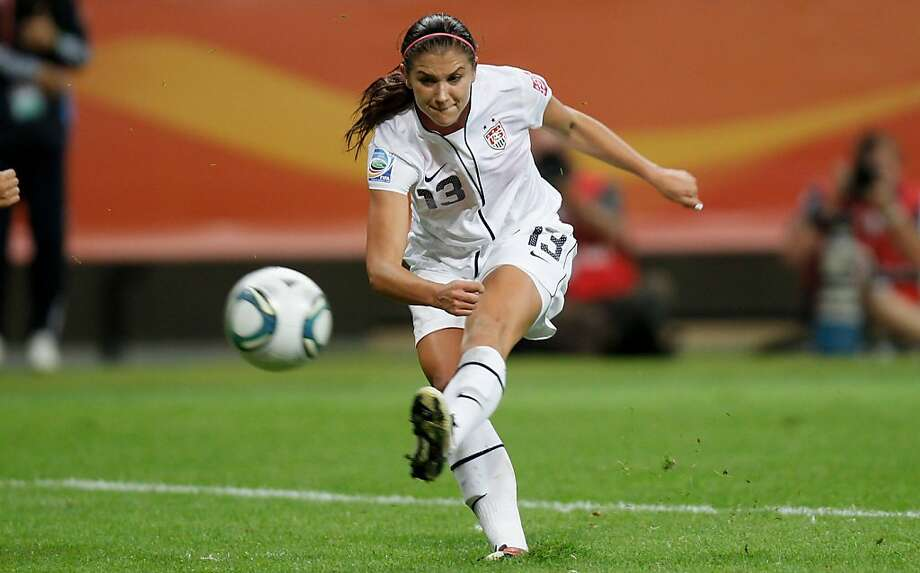 Alex Morgan runs with the ball during the FIFA Women's World Cup Final match, Japan vs. USA, in Frankfurt, Germany. Photo: Friedemann Vogel, Getty Images