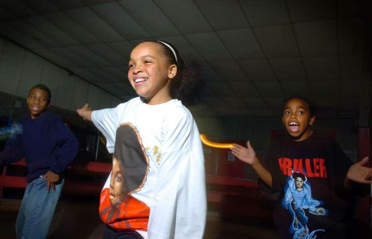 Ten-year-old Deandra Bloschichak, of Bridgeport, skates with frieds during