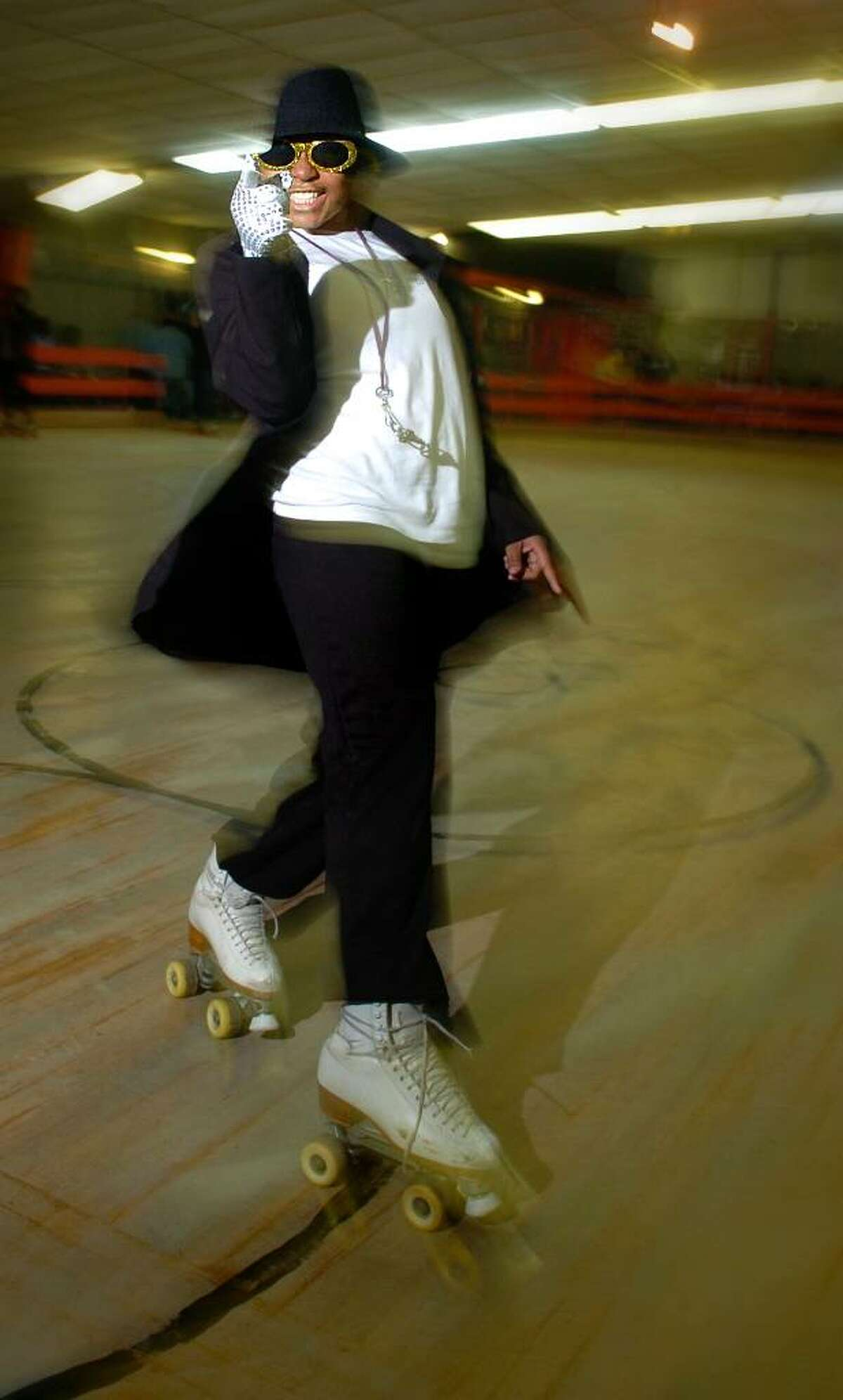 Twelve-year-old Tiajah Smith, of Bridgeport, skates by doing her best Michael Jackson impersonation for