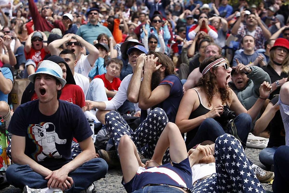 Bill Bowles, center, covers his face as Japan scores a point at the U.S. vs Japan World Cup championship game shown on a large screen at San Francisco's Civic Center Plaza on Sunday, June 17, 2011. Japan won 3-1 in a penalty shootout after coming from behind twice in a 2-2 tie.