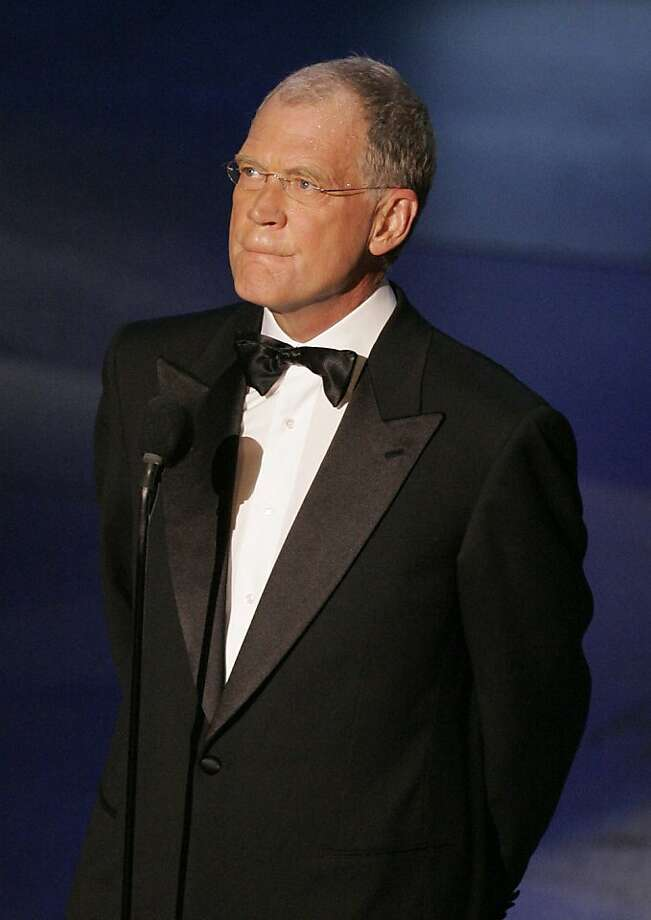 FILE - In this Sept. 18, 2005 file photo Late night talk show host David Letterman makes a surprise appearance at the Primetime Emmy Awards in Los Angeles. (AP Photo/Mark J. Terrill, File) Photo: Mark J. Terrill, AP