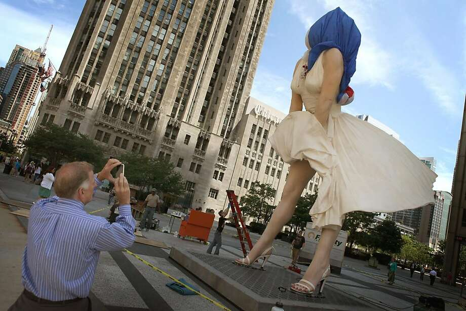 CHICAGO, IL - JULY 14:  Workers put some finishing touches on ''Forever Marilyn'', a sculpture by Seward Johnson, on July 14, 2011 in Chicago, Illinois. The stainless steel and aluminum sculpture which stands 26 feet tall and weighs 34,000 pounds will beunveiled tomorrow and remain on display in Chicago through the spring of 2012. The sculpture was inspired by Marilyn Monroe's iconic scene in the 1955 movie Seven Year Itch. Photo: Scott Olson, Getty Images