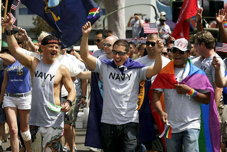 "Military personel march down University Avenue during the San Diego gay pride parade July 16, 2011 in San Diego, California. About 200 active-duty troops and veterans from every branch of the military participated for the first time in the march as the ban on the government policy on homosexuals serving in armed forces, or ""Don't ask Don't Tell"", remains in flux in the justice system Photo: Sandy Huffaker, Getty Images"