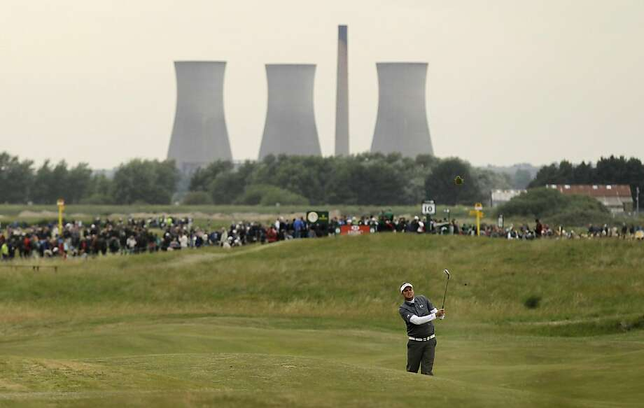 Jeff Overton of the US plays a shot on the 10th fairway during the first day of the British Open Golf Championship at Royal St George's golf course Sandwich, England, Thursday, July 14, 2011. Photo: Matt Dunham, AP