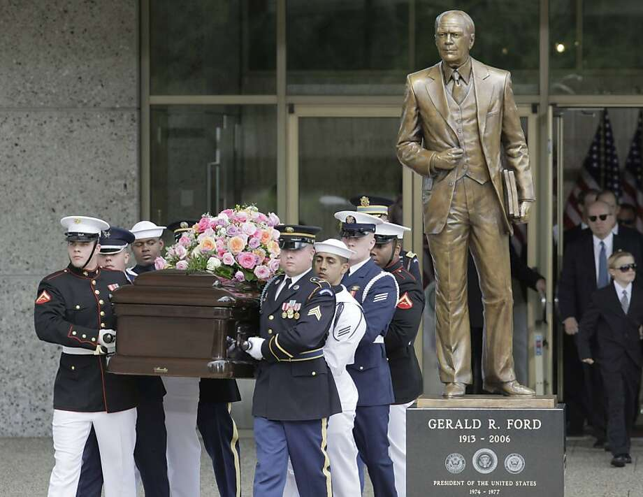 A military honor guard carries the casket bearing the body of former first lady Betty Ford as they pass a statue of the former President at the Gerald R. Ford Presidential Museum in Grand Rapids, Mich., Thursday, July 14, 2011, prior to funeral services at Grace Episcopal Church. Photo: M. Spencer Green, AP