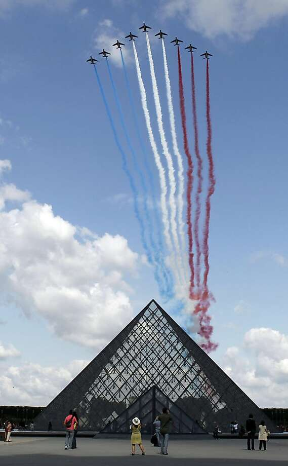 The French ''Patrouille de France'' performs over the Louvre Pyramid during the annual Bastille day parade in Paris, on July 14, 2011. TOPSHOTS/ Photo: Thomas Coex, AFP/Getty Images