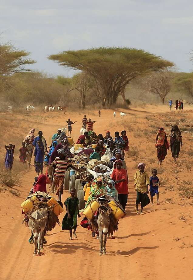 Somalis fleeing hunger in their drought-stricken nation walk along the main road leading from the Somalian border to the refugee camps around Dadaab, Kenya, Wednesday, July 13, 2011. More than 11 million people in the Horn of Africa are confronting the worst drought in decades and need urgent assistance to stay alive, U.N. Secretary-General Ban Ki-moon said Tuesday. Ban called an emergency meeting Tuesday morning with the heads of U.N. agencies to discuss the worsening drought in East Africa, which alongwith fighting in Somalia has created a humanitarian crisis. Photo: Rebecca Blackwell, AP