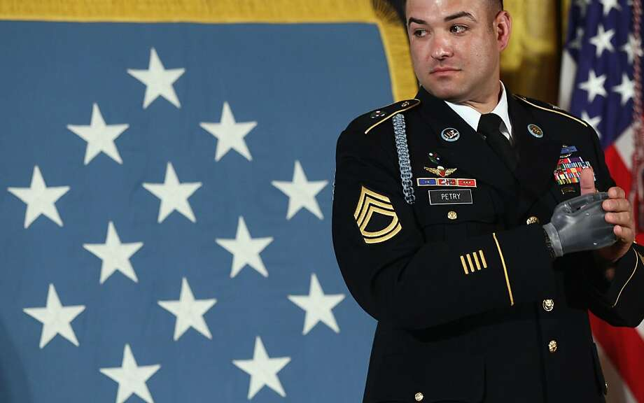 WASHINGTON, DC - JULY 12:  U.S. Army Sgt. 1st Class Leroy Petry looks at family members during a ceremony awarding him the Medal of Honor at the White House July 12, 2011 in Washington, DC. Petry, who received the medal for his courageous actions during operations in Paktia, Afghanistan, in May 2008, is the second living, active duty service member to be awarded the Medal of Honor for actions in Iraq or Afghanistan.  (Photo by Win McNamee/Getty Images)  *** BESTPIX *** Photo: Win McNamee, Getty Images