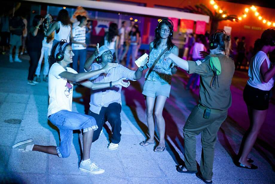TEL AVIV, ISRAEL - JULY 12:  (Israel out)  Israeli Youths and soldiers celebrate Summer At Silent Disco party on July 12, 2011 in Tel Aviv, Israel. In order to prevent excess noise from bothering others within the surrounding neighborhood, youth wear headphones synchronized to the music while dancing amongst one another. Photo: Uriel Sinai, Getty Images