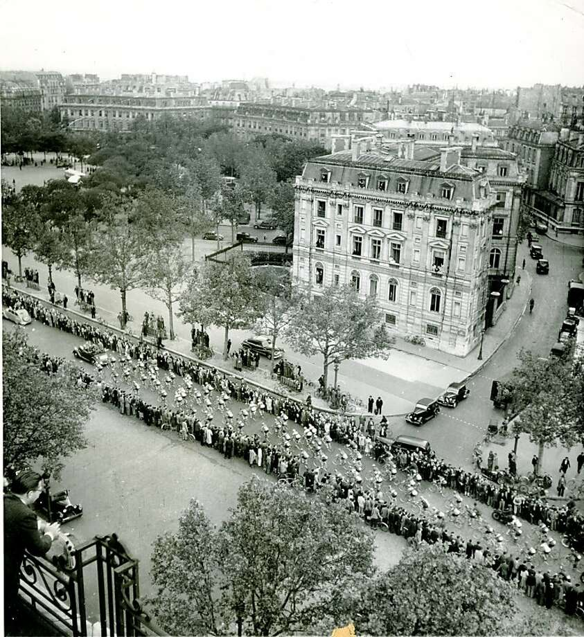 1948 Tour de France Begins:  Contestants in the 1948 Tour de France parade up the Champs Elysees, Paris, en route to Porte de St. Cloud for the start of France's most important sports event.  The race lasts for about a month, over a course 5,000 kilometers in Length. Photo: World Wide Photo