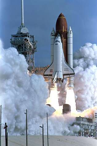 In this dated April 24, 1990 filed photo shows the Shuttle Discovery lifts off launch pad, carrying a crew of five and the Hubble Space Telescope. Hubble, the first space telescope which revolutionized astronomy and our vision of the universe bytransmitting images of remote galaxies.  The US space shuttle is part cargo truck, part passenger bus, part airplane built for orbit, and has known soaring highs and devastating lows during its 30-year career in spaceflight.  The shuttle program was bornin 1972 with the decision by president Richard Nixon to launch the program, which would become the major focus of US human spaceflight ambitions over the next four decades.  The shuttle program launched its first return-to-flight mission in September 19 Photo: Bob Pearson, AFP/Getty Images