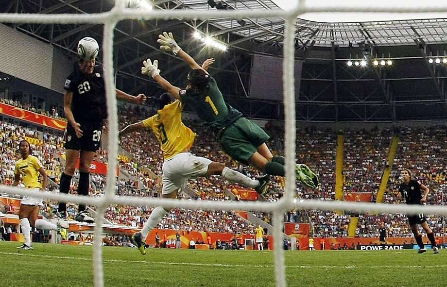 United States' Abby Wambach scores her side's 2nd goal during the quarterfinal match between Brazil and the United States at the Womens Soccer World Cup in Dresden, Germany, Sunday, July 10, 2011. Photo: Marcio Jose Sanchez, AP