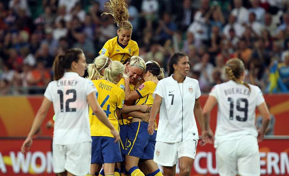 Nilla Fischer (C) of Sweden celebrates after she schore their team's 2nd goal during the FIFA Women's World Cup 2011 Group C match between Sweden and USA at Wolfsburg Arena on July 6, 2011 in Wolfsburg, Germany. Photo: Martin Rose, Getty Images