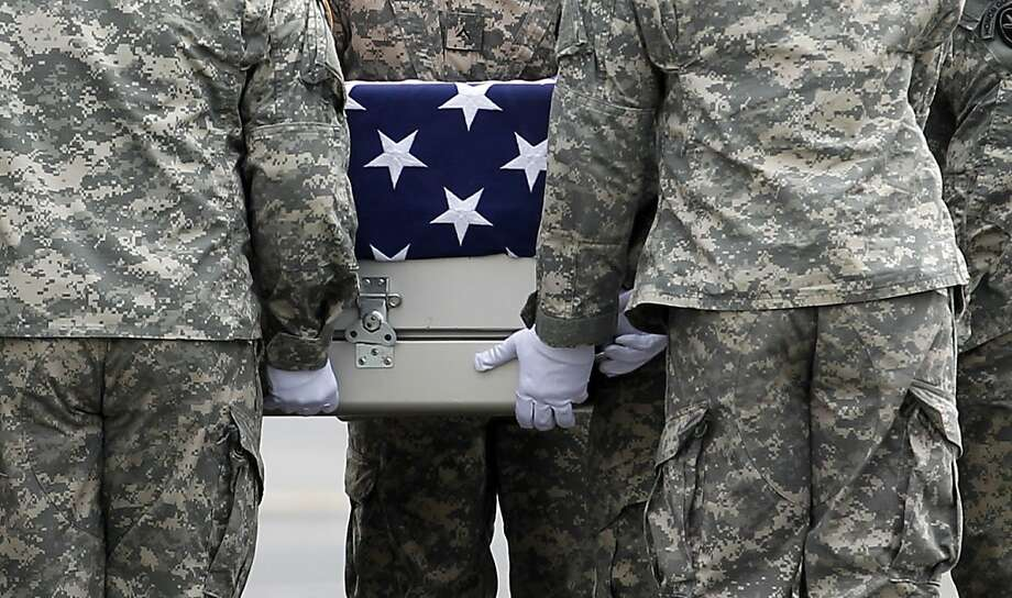 An Army carry team carries the transfer case containing the remains of Army Staff Sgt. Michael J. Garcia of Bossier City, La. upon arrival at Dover Air Force Base, Del. on Wednesday, July 6, 2011. The Department of Defense announced the death of Garcia who was supporting Operation Enduring Freedom in Afghanistan. Photo: Jose Luis Magana, AP
