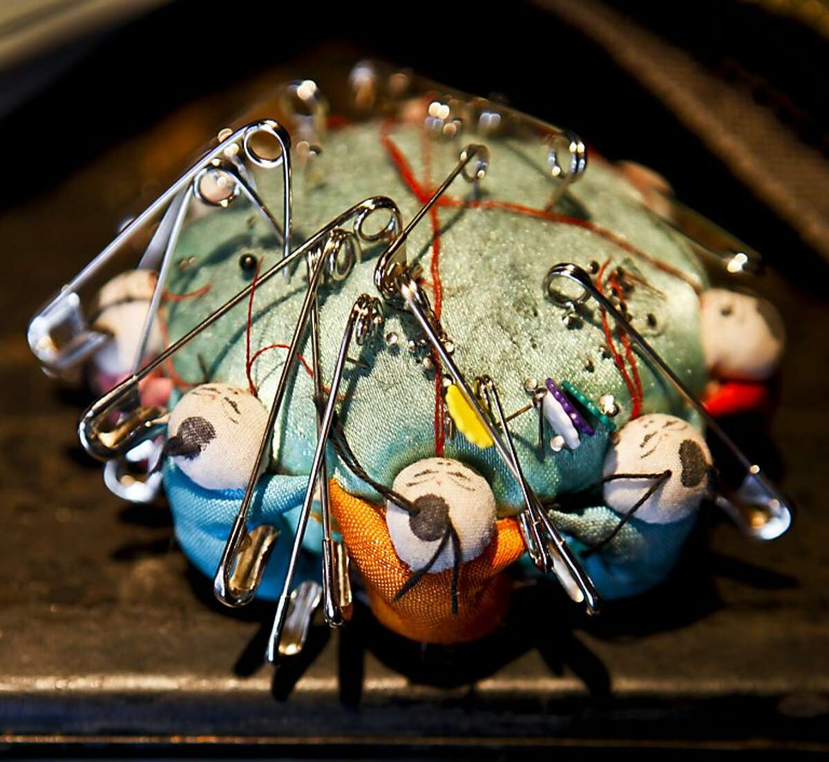 A pin cushion sits on a shelf in tailor and shoemaker Al Ribaya's store, Al's Attire, in North Beach on Tuesday, May 17, 2011 in San Francisco, Calif.