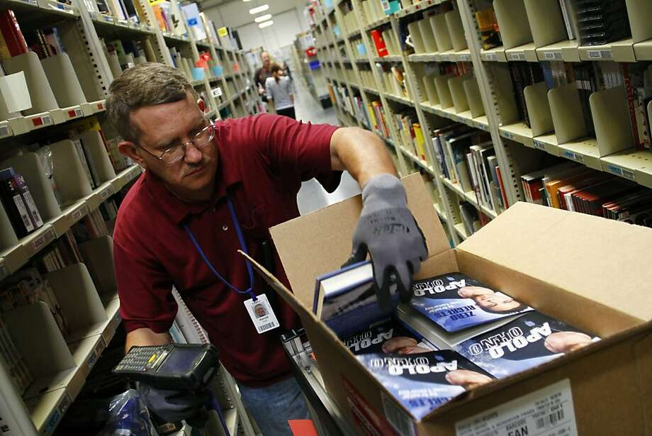 Harold Fehr stocks merchandise at the Amazon.com Phoenix Fulfillment Center in Phoenix, Arizona, U.S., on Thursday, Nov. 11, 2010. Amazon.com Inc., the world's largest online retailer, said it will increase the royalty it offers to magazine and newspaper publishers for titles sold in the Kindle Store to 70 percent. Photographer: Joshua Lott/Bloomberg *** Local Caption *** Harold Fehr   Ran on: 11-29-2010 Harold Fehr works at an Amazon.com center in Phoenix. Amazon Prime guarantees order delivery within two days.  Ran on: 04-05-2011 Harold Fehr stocks merchandise at the Amazon.com Fulfillment Center in Phoenix. Legislation would require Amazon to collect the California use tax. Photo: Joshua Lott, Bloomberg