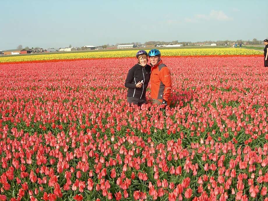 Vicki and Martin embedded in tulips Photo: Martin And Victoria Russell