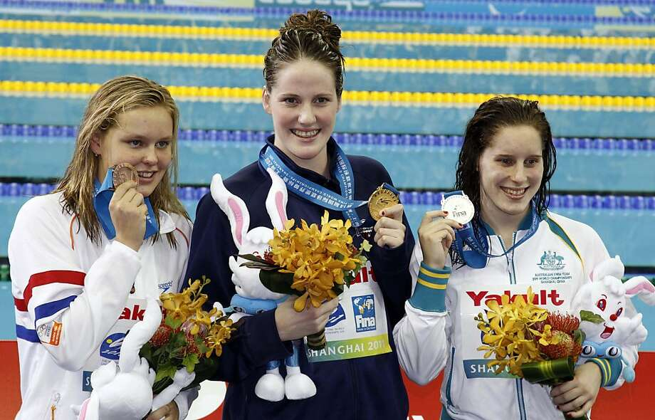 U.S. Melissa Franklin, center, shows the gold medal she won in the women's 200m Backstroke, flanked by silver medalist Australia's Belinda Hocking, left, and Sharon Van Rouwendaal of the Netherlands, bronze, at the FINA Swimming World Championships in Shanghai, China, Saturday, July 30, 2011. Photo: Ng Han Guan, AP