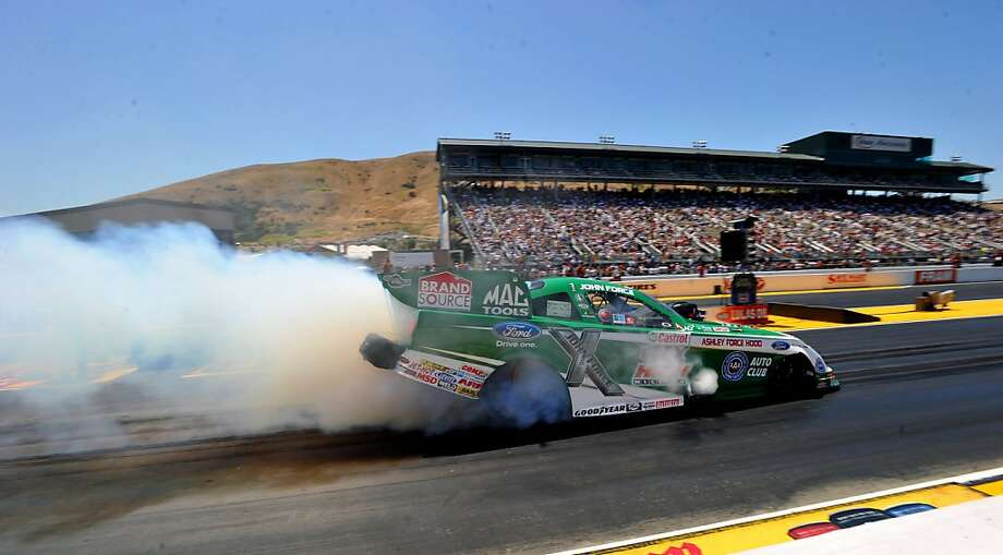 In this photo provided by Ford Motor Co., John Force races at Infineon Raceway in Sonoma, Calif. to earn his 139th career No. 1 qualifier, Saturday, July 30, 2011. Photo: Sam VarnHagen, AP