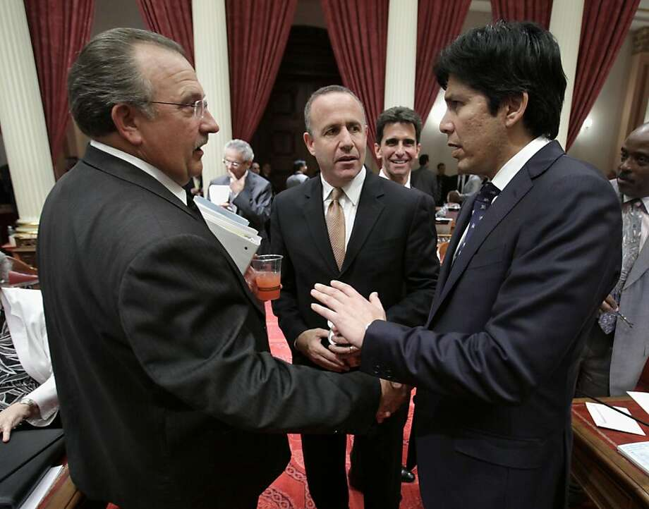 Senate Minority Leader Bob Dutton, R-Rancho Cucamonga, left, shakes hand with Sen. Kevin deLeon, D-Los Angeles, as Senate President Pro Tem Darrell Steinberg, D-Sacramento,  looks on after  the debater over the state budget at the Capitol in Sacramento,Calif., Wednesday, June 15, 2011.  By a 23-15 party-line vote, the Senate approved the budget plan and sent it to the Assembly for approval. Photo: Rich Pedroncelli, AP