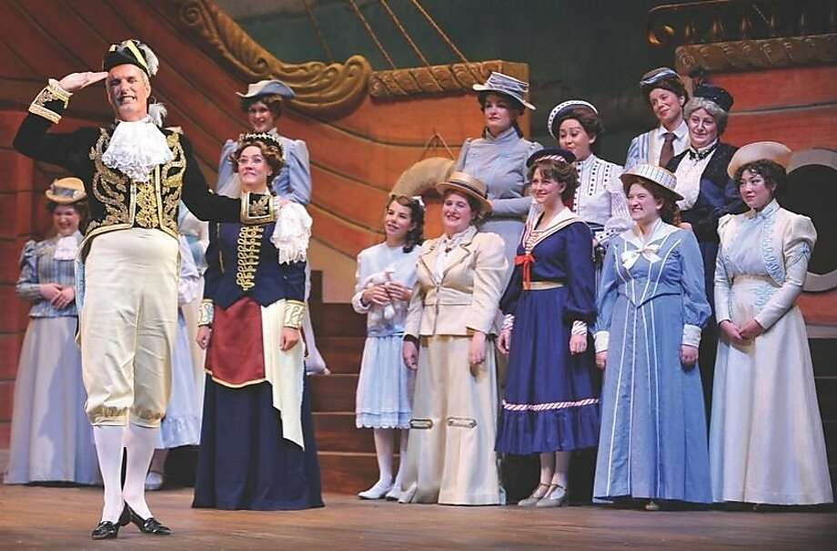 """Sir Joseph Porter, First Lord of the Admiralty (F. Lawrence Ewing, left), is admired by his sisters, cousins and aunts in Lamplighters Music Theatre's production of Gilbert & Sullivan's """"H.M.S. Pinafore."""" Photo: David Allen 2011"""