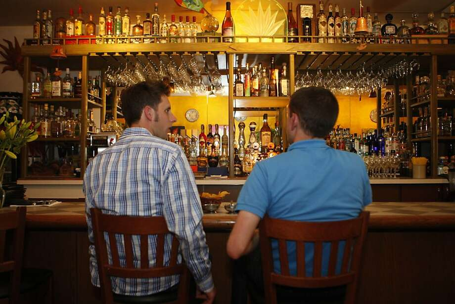 Two regulars sit at the bar at Palo Alto Sol in Palo Alto Calif.,  on July 22, 2011. Photo: Audrey Whitmeyer-Weathers, The Chronicle