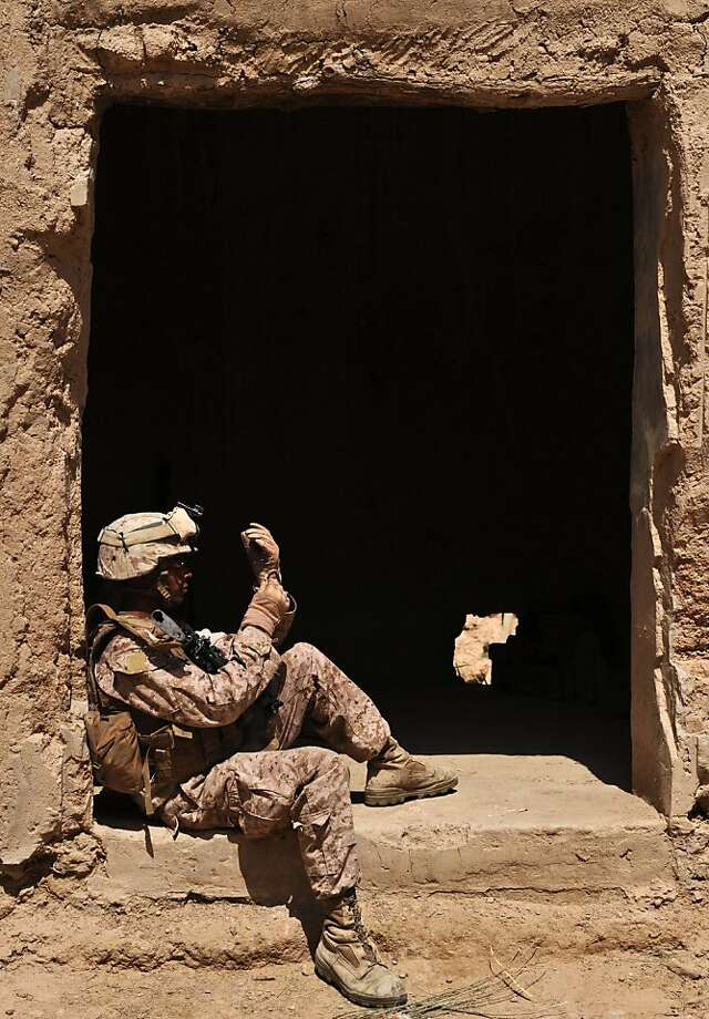 A US Marine from 3rd Battalion 9th Marines Kodiak Company rests during a patrol at Kote Tazagul area in Marjah district in Helmand Province. US lawmakers saw momentum for political reconciliation in Afghanistan in the wake of Osama bin Laden's death, but voiced fear that the fight against extremism was floundering in Pakistan. Photo: Massoud Hossaini, AFP/Getty Images
