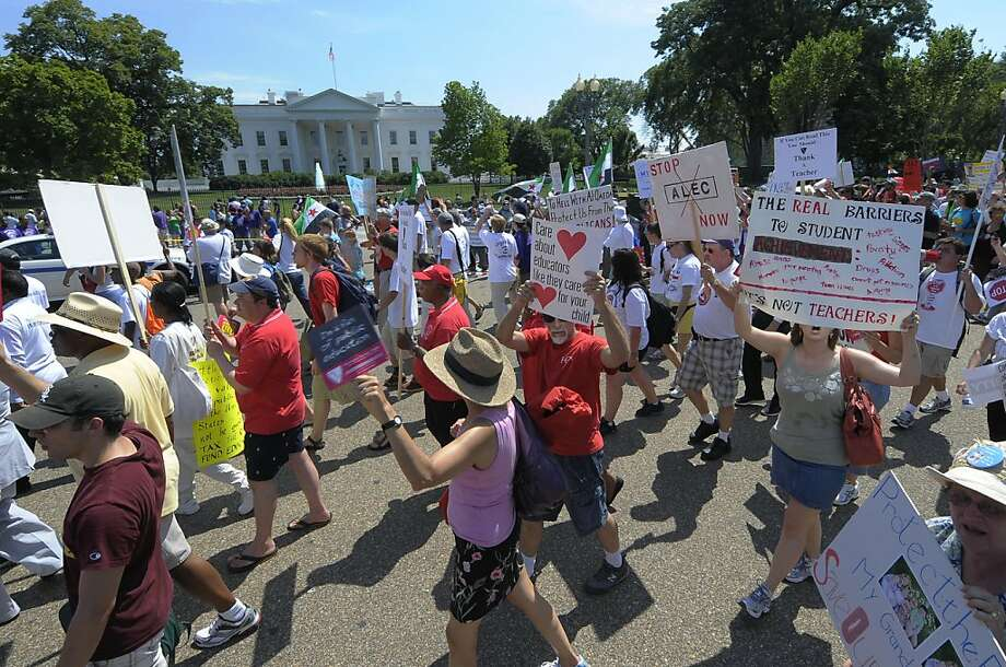 "WASHINGTON, DC - JULY 30, Teachers march past The White House during a ""Save Our Schools"" rally in Washington on July 30, 2011. In background is a anti-President Assad rally. Just across the street from The White House in Lafayette Park was a pro-President Assad rally. The two Assad rallies were chanting against each other until the ""Save Our Schools"" marchers passed. Then both Assad rallies cheered in favor of the teacher's rally.  (Photo by Tracy A Woodward/The Washington Post) WASHINGTON TIMES OUT  NEW YORK TIMES OUT  USA TODAY OUT   DC EXAMINER OUT    NO Network TV. NO SALES  NO ARCHIVES  NO MAGAZINES  MANDATORY CREDIT Photo: Tracy A Woodward, Washington Post"