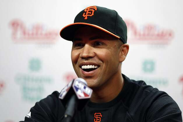 San Francisco Giants' Carlos Beltran laughs during a news conference before a baseball game against the Philadelphia Phillies, Thursday, July 28, 2011, in Philadelphia. The defending World Series champion Giants completed a trade Thursday to acquire the All-Star outfielder and cash from the New York Mets, upgrading their inconsistent offense. Photo: Matt Slocum, AP