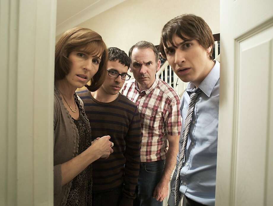 FRIDAY NIGHT DINNER Mom (Tamsin Greig), Adam (Simon Bird), Dad (Paul Ritter), and Jonny (Tom Rosenthal) Photo: Dave KIng, BBC