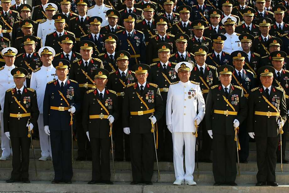 This photograph, taken on August 28, 2010, shows the Turkish Chief of Staff General Isik Kosaner (4th R) and other top commanders posing for cameras at the mausoleum of Turkey's founder Kemal Ataturk in Ankara.  General Isik Kosaner stepped down on July 29, 2011, and the entire military command have resigned in a row with the government over promotions for generals held in an alleged anti-government plot, Turkish media reported. Photo: Adem Altan, AFP/Getty Images