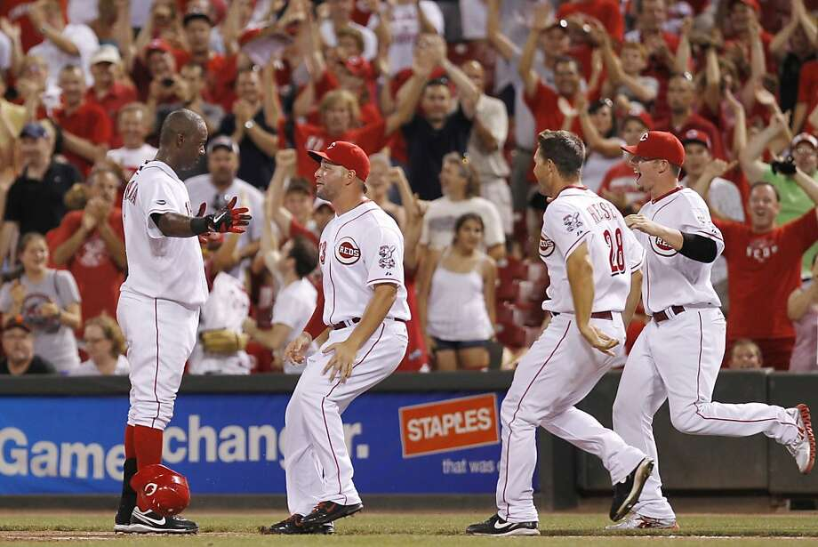 CINCINNATI, OH - JULY 29: Edgar Renteria #16 of the Cincinnati Reds celebrates with teammates after hitting the game-winning single in the 13th inning against the San Francisco Giants at Great American Ball Park on July 29, 2011 in Cincinnati, Ohio. The Reds won 4-3. Photo: Joe Robbins, Getty Images