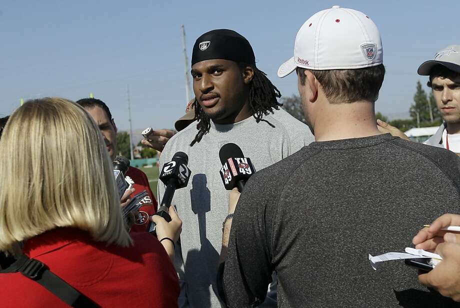 San Francisco 49ers defensive lineman Ray McDonald, center, speaks to reporters after NFL football training camp in Santa Clara, Calif., Friday, July 29, 2011. Photo: Jeff Chiu, AP