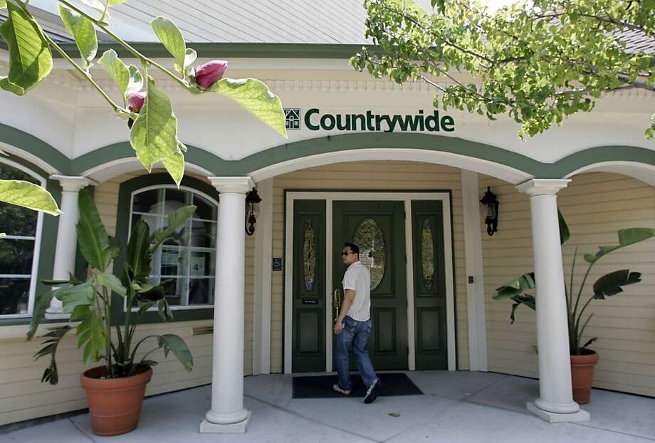 A customer walks into a Countrywide office in San Jose, Calif., Wednesday, June 25, 2008.  Countrywide Financial Corp. says stockholders controlling a majority of the mortgage lender's outstanding shares have approved the company's takeover by Bank of America Corp. (AP Photo/Paul Sakuma) Photo: Paul Sakuma, AP