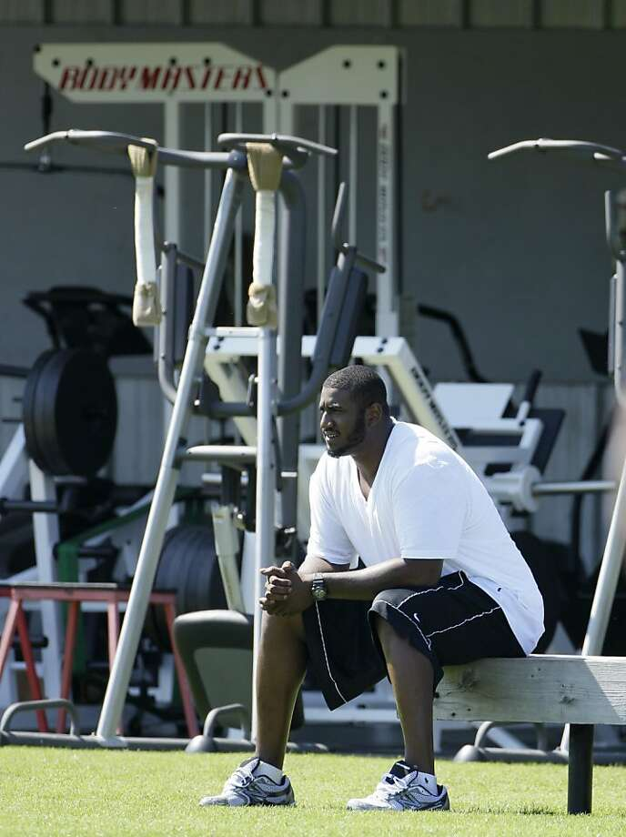 Oakland Raiders offensive lineman Jared Gaither watches workouts during their NFL football training camp in Napa, Calif., Friday, July 29, 2011. Photo: Eric Risberg, AP