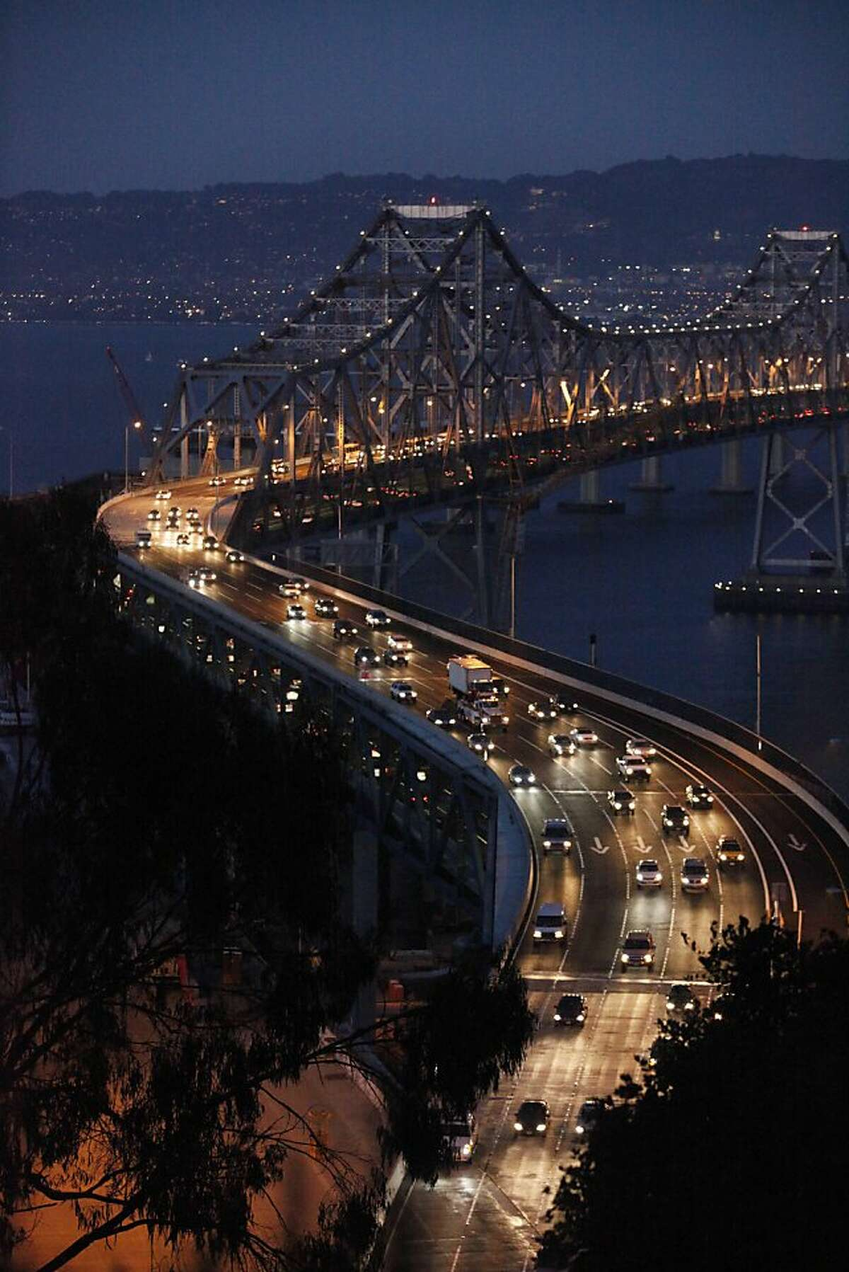 Friday night commuters reduce there speed going through the newest curve on the Bay Bridge on Friday Sep. 18, 2009 in San Francisco, Calif.