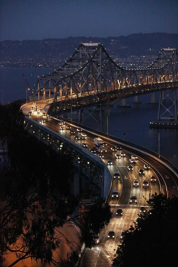 Friday night commuters reduce there speed going through the newest curve on the Bay Bridge on Friday Sep. 18, 2009 in San Francisco, Calif. Photo: Mike Kepka, The Chronicle