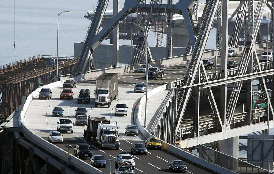 Commuters cross the Bay Bridge and it's new S curve section early Tuesday Sept 8, 2009. Cal-Trans finished their repairs early on the cracked eye-bar, reopening the bridge at 7am only two hours past their target time of 5am. Photo: Lance Iversen, The Chronicle