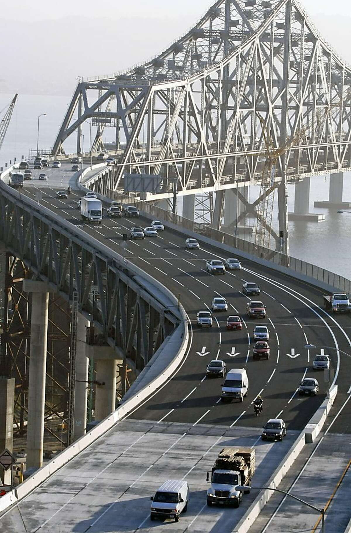 Commuters across the Bay Bridge and the new S curve section early Tuesday Sept 8, 2009. Cal-Trans finished their repairs early on the cracked eye-bar, reopening the bridge at 7am only two hours past their target time of 5am.