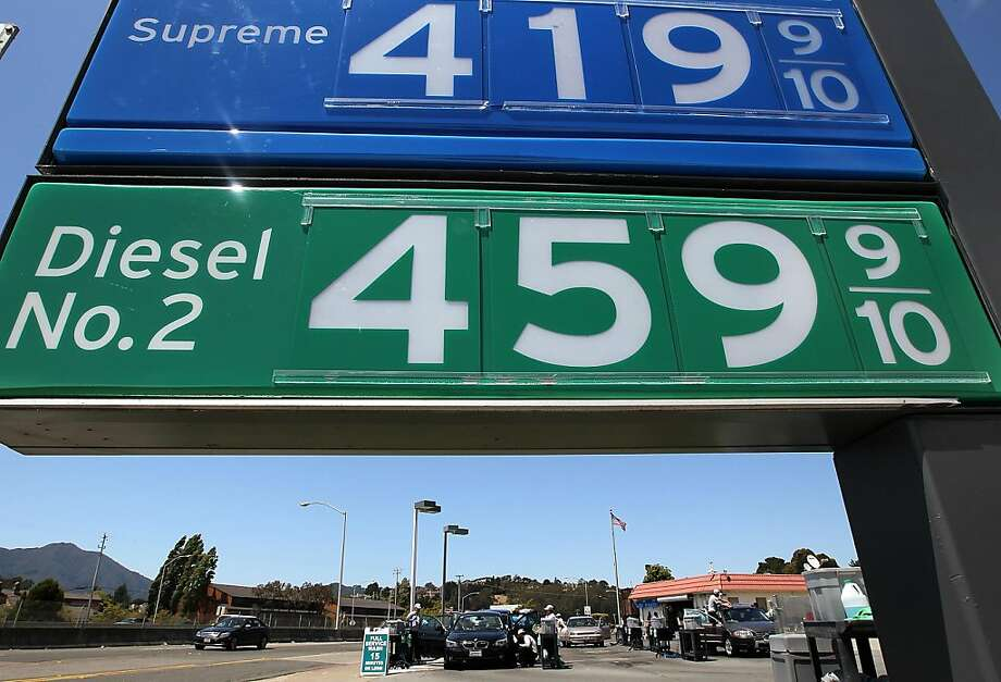 Gas prices over $4 per gallon are displayed at a Chevron gas station on July 29, 2011 in Mill Valley, California.  The U.S. Commerce Department reported today that the U.S. economy slowed in the second quarter with the GDP coming in at 1.3 percent, far lower than expected. Photo: Justin Sullivan, Getty Images