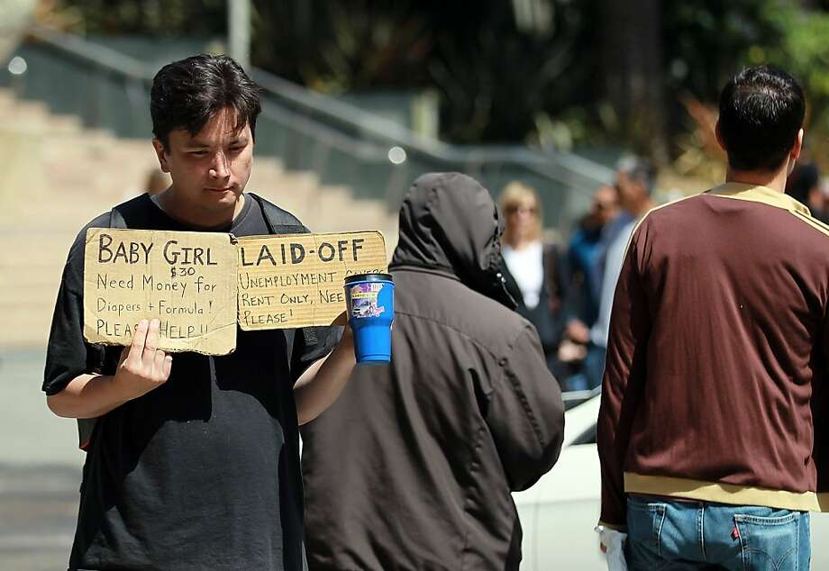 SAN FRANCISCO, CA - JULY 29:  A man begs for money on Geary Boulevard July 29, 2011 in San Francisco, California.  The U.S. Commerce Department reported today that the U.S. economy slowed in the second quarter with the GDP coming in at 1.3 percent, far lower than expected. Photo: Justin Sullivan, Getty Images