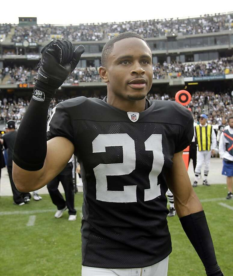 FILE - This Sept. 19, 2010, file photo shows Oakland Raiders cornerback Nnamdi Asomugha (21) at an NFL football game in Oakland, Calif. The challenge: taking more than 1,000 players and sorting them onto 32 rosters, working out contracts that must be signed and then processed by the league office, with every deal from rookies to free agents fitting under the salary cap and falling within the other boundaries of the new, still-being-understood labor agreement _ and, getting all this done in time for the start of the preseason, preferably by the start of training camp. Photo: Paul Sakuma, AP