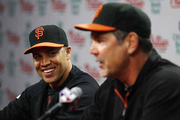 San Francisco Giants' Carlos Beltran, left, laughs as manager Bruce Bochy speaks during a news conference before a baseball game against the Philadelphia Phillies, Thursday, July 28, 2011, in Philadelphia. The defending World Series champion Giants completed a trade Thursday to acquire the All-Star outfielder and cash from the New York Mets, upgrading their inconsistent offense. Photo: Matt Slocum, AP