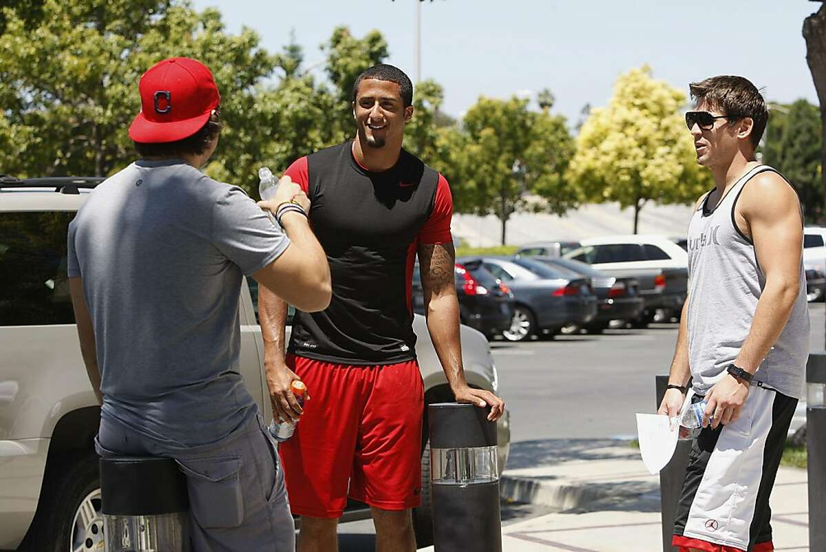 Keaton Kristick (left) talking to 49er's quarterback Colin Kaepernick (middle) and Kevin Jurovich (right) as they report for training camp at the 49ers headquarters in Santa Clara, Calif., on Tuesday, July 26, 2011.