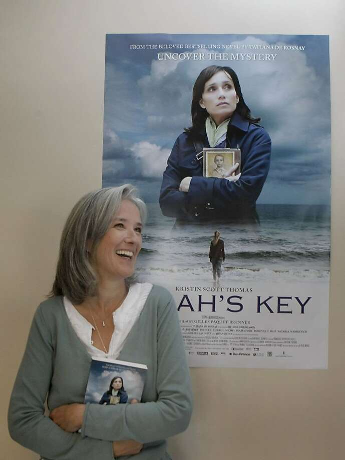 "Best-selling author Tatiana de Rosnay, whose novel ""Sarah's Key"" has been adapted into a film starring Kristin Scott Thomas, poses in front of the movie's poster in San Francisco Calif.,  on July 14, 2011. Photo: Audrey Whitmeyer-Weathers, The Chronicle"