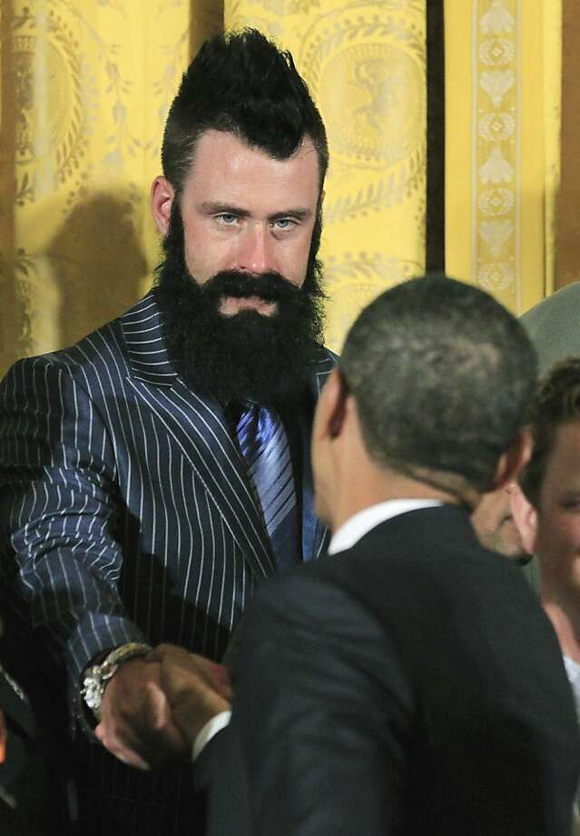 President Barack Obama greets San Francisco Giants baseball pitcher Brian Wilson in the East Room of the White House in Washington, Monday, July 25, 2011, during a ceremony honoring the 2010 World Series baseball champions. Photo: Manuel Balce Ceneta, AP