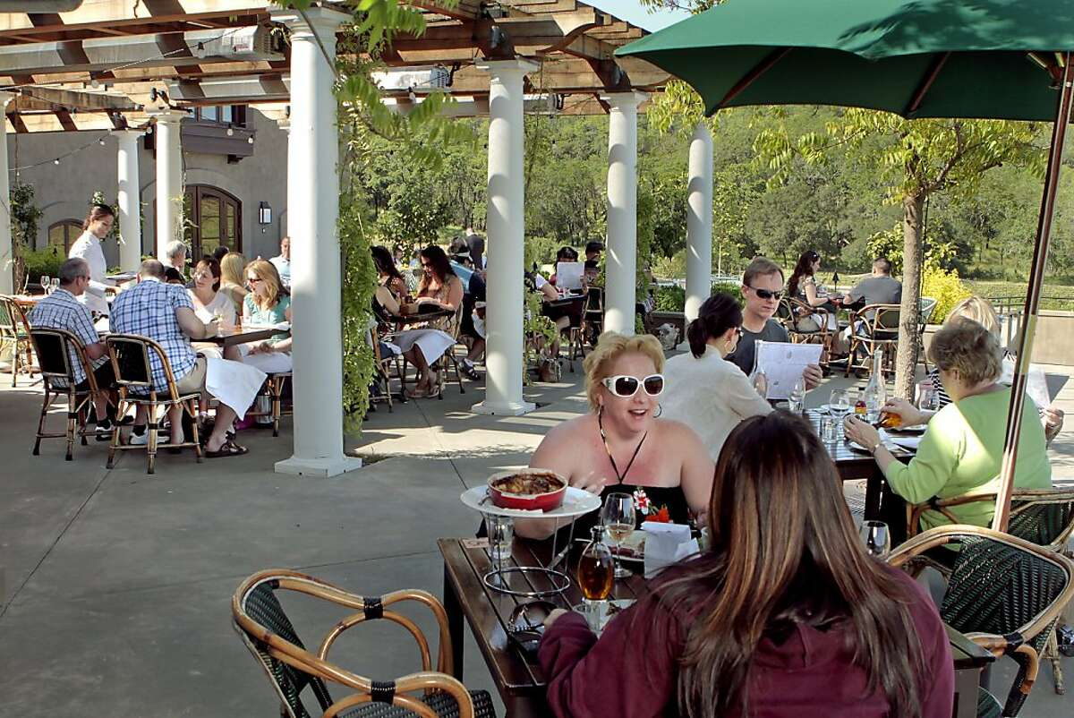 Diners enjoy the patio at Rustic Restaurant at Francis Ford Coppola's Winery in Geyserville.